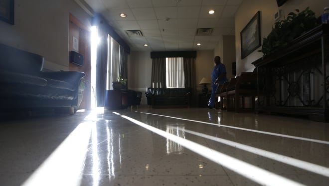 A ban of light pokes through the curtains in the main waiting room of Calhoun Liberty Hospital in Blountstown.