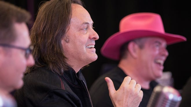 T-Mobile President and CEO John Legere, center, along with T-Mobile Chief Operating Officer Mike Sievert, left, and T-Mobile CFO Braxton Carter, right.