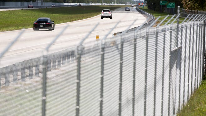 The Florida Department of Transportation recently constructed a 10-foot high fence, topped with barbwire, to prevent panthers from crossing Interstate 75. The fence, which starts just east of the Naples tollbooth, runs nine miles to the Faka Union Canal on both sides of the interstate.