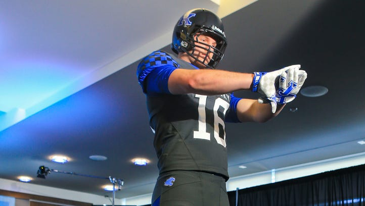 Kentucky's C.J. Conrad with the grey uniform during the unveiling Friday at Commonwealth Stadium.