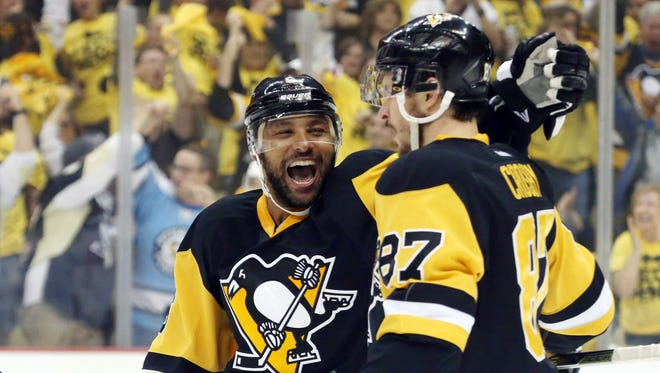 Pittsburgh Penguins defenseman Trevor Daley (6) celebrates his goal with center Sidney Crosby (87) against the Washington Capitals during the first period in game four of the second round of the 2016 Stanley Cup Playoffs at the CONSOL Energy Center.