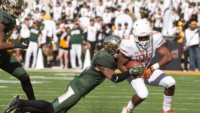 Dec 5, 2015; Waco, TX, USA; Texas Longhorns wide receiver Ryan Newsome (17) is tackled by Baylor Bears safety Chance Waz (18) during the game at McLane Stadium. The Longhorns defeat the Bears 23-17.