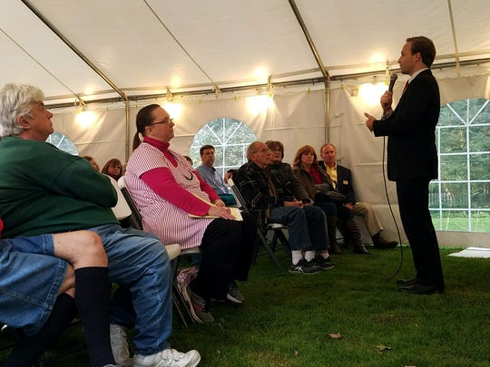 Michigan Lt. Gov. Brian Calley talks with residents at a town hall outside of Inn the Garden B & B in Lexington on Tuesday, Oct. 11, 2017.
