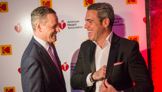 Kodak CEO Jeff Clarke speaks to Marc Natale of the American Heart Association at the start of the Oscars-themed fundraiser.