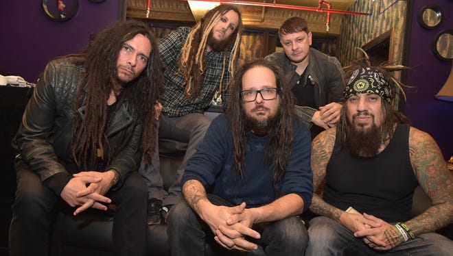 "James ""Munky"" Schaffer, Brian ""Head"" Welch, Jonathan Davis, Ray Luzier and Reginald Quincy ""Fieldy"" Arvizu backstage at The Korn 20th Anniversary Tour  at Irving Plaza on October 5, 2015 in New York City."