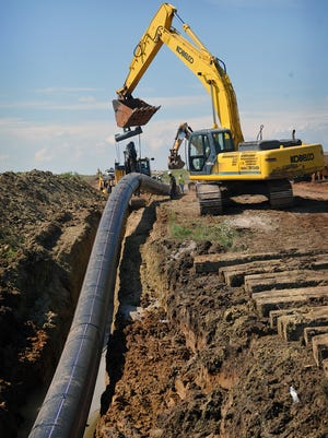Crews lay a 500-foot section of high-density polyethylene water pipe in a trench near Lake Arrowhead. The 36-inch line will carry treated effluent water from the River Road Treatment Plant 17 miles to the lake where it will be blended with the lake water.
