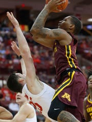 Minnesota's Dupree McBrayer, right, charges Ohio State's Kyle Young during the first half of an NCAA college basketball game Sunday, Dec. 2, 2018, in Columbus, Ohio. (AP Photo/Jay LaPrete)