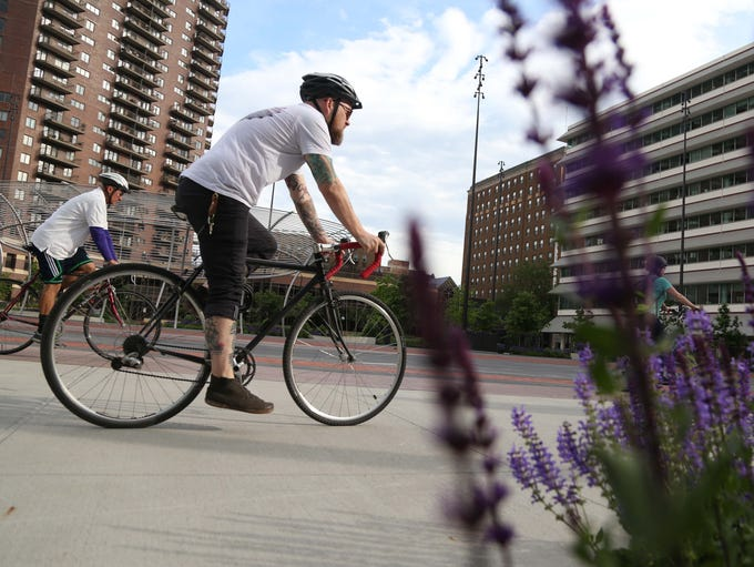 Riders pass through Cowles Commons during the first