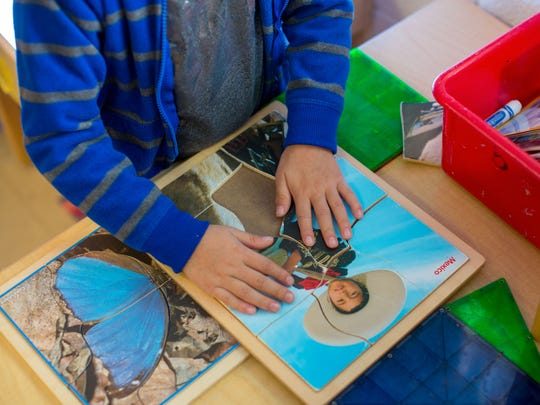 "Alejandro Vazquez puts together a puzzle of a young charro, or Mexican cowboy, at the Anthony Elementary pre-K in southern New Mexico. The class is part of the Gadsden Independent School District ""On Track"" pre-K system that serves 500 4-year-olds in southern Doña Ana County."