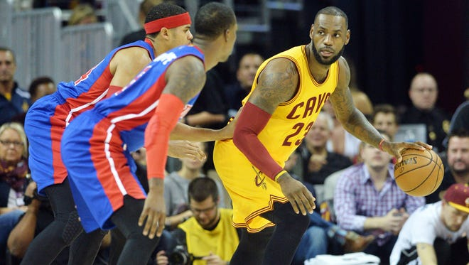 Cavaliers forward LeBron James (23) works against the Pistons during the first quarter Friday in Cleveland.
