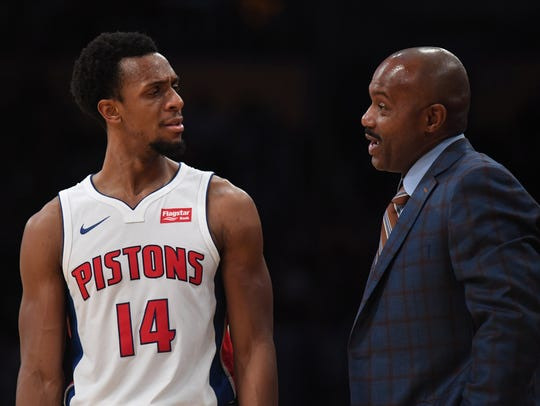 Pistons assistant coach Tim Hardaway, right, reacts