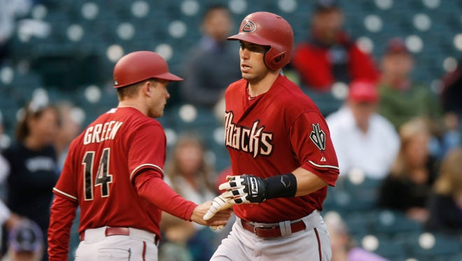 Arizona Diamondbacks first baseman Paul Goldschmidt is congratulated by third base coach Andy Green as he circles the bases after hitting a solo home run against the Colorado Rockies in the fourth inning of the second game on May 6, 2015, in Denver.