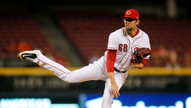 Cincinnati Reds relief pitcher Deck McGuire (68) follows through on a pitch in the top of the seventh inning of the game between the Cincinnati Reds and the St. Louis Cardinals at Great American Ball Park on Sept. 20, 2017.