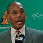 D.A. Robin/Special to the Democrat; 12/23/2014; FAMU's Galimore-Powell Fieldhouse Florida A&M University's newest head football coach Alex Wood speaks to reporters and others Tuesday at the Galimore-Powell Fieldhouse. Wood replaces Earl Holmes who was fired in October after the team lost more than 15 games between 2013 and 2014. The new coach promised to raise the standards of play on and off the field and win games in the coming season. Wood refused to discuss plans for hiring or firing existing staffers with reporters.