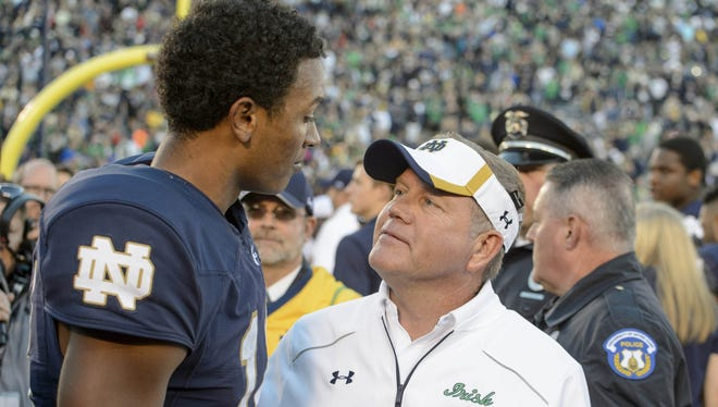 Notre Dame quarterback DeShone Kizer (left) and coach Brian Kelly