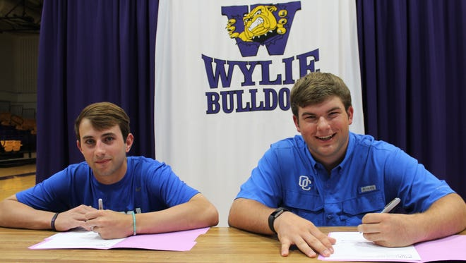 Wylie High senior baseball players Sam King, left, and Connor Carlton signed Tuesday with Odessa College.