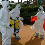 World Health Organization officials investigate an Ebola outbreak in Uganda in 2012.