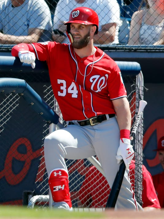 Washington Nationals' Bryce Harper stands on the dugout steps as he waits to bat during the first inning of an exhibition spring training baseball game against the Houston Astros, Saturday, March 3, 2018, in West Palm Beach, Fla. (AP Photo/Jeff Roberson)