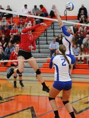 Canton's Hannah Madis (No. 3) hits the ball over the
