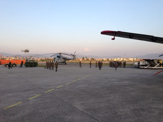 Military personnel work at the airport in Kathmandu, where a lot of the international aid has arrived after the April 25 earthquake.
