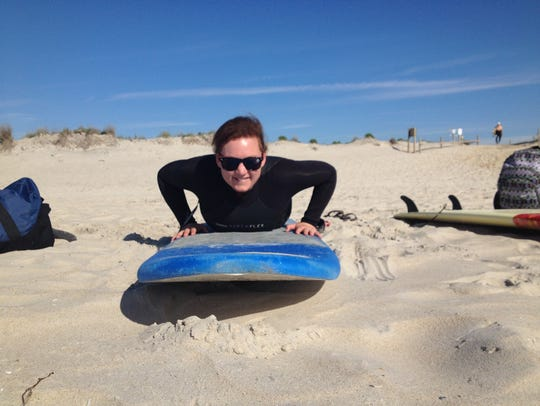 Jennifer Cox gets oriented during her first surfing