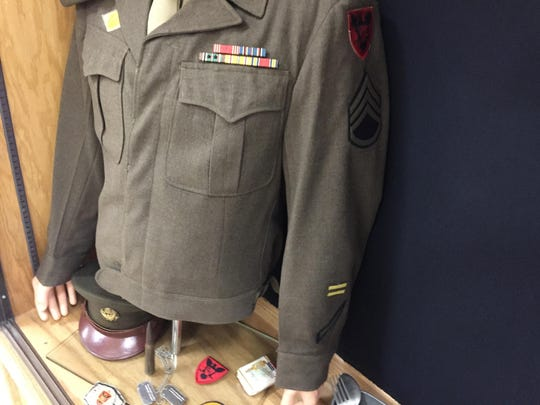 Military memorabilia of Edward C. Reed Jr. in the display case at Reed High School, Sparks.