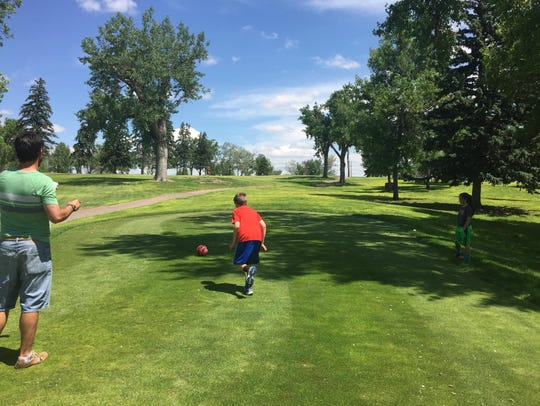 Valon Haslem, 11, tees off at the new footgolf course