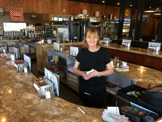 Lynn Herlson, a waitress at Tracys in downtown Great