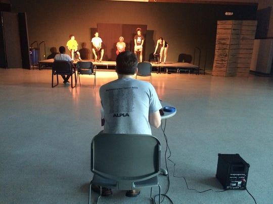 Matt Falduto, center, watches as his actors start a