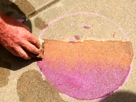 Using a damp sponge to blend dry chalk will allow the colors to seep through the pores of the concrete.