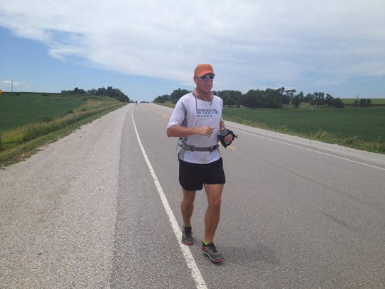 Richard Kresser runs along the RAGBRAI route. He said he was 49 miles into a 107 mile run July 23, 2013. This year, he is riding,  no running.