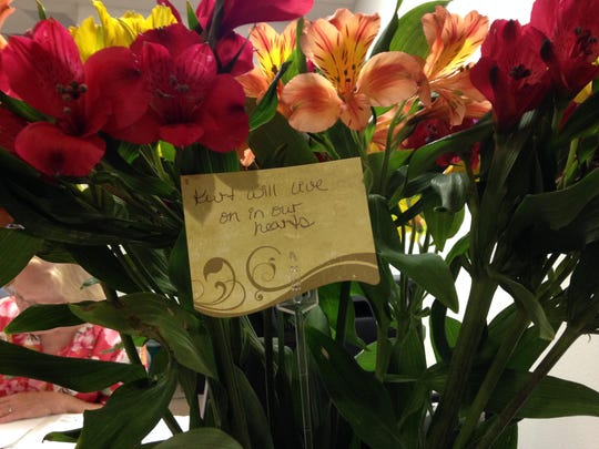 A visitor to the Justiceworks building in Stevens Point Thursday, July 16 left a bouquet of flowers in Helminiak's memory.