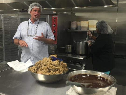 Comfy Cow founder Tim Koons-McGee shows off his new J-town plant and a batch of hand-crafted cookie dough and hot fudge for the premium ice cream. July 21, 2015.