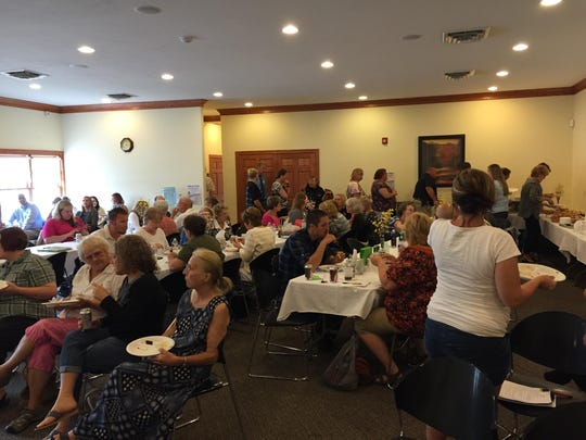 Dozens of Manitowoc residents take a lunch break during