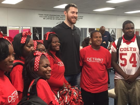 New Pistons big man Aron Baynes poses with students at Detroit Collegiate Preparatory High School at Northwestern. Baynes helped renovate the school's library.
