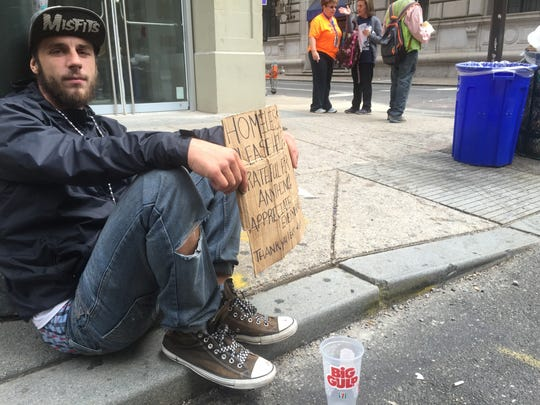 """John Scott, 34 , is homeless and described Pope Francis as """"really down to earth - in touch with the people, in touch with humanity."""""""
