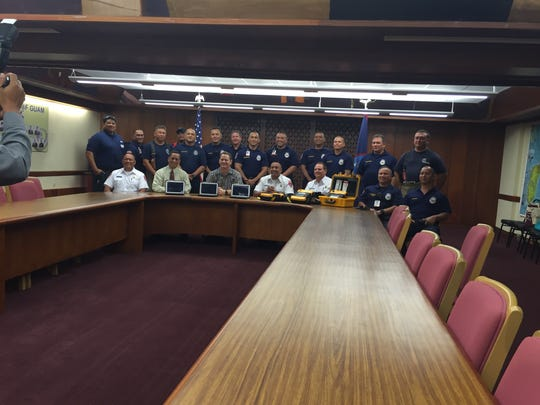 Lt. Gov. Ray Tenorio and Guam Fire Department officials pose for a photo at a presentation for new equipment for the department on Oct. 7 at the Adelup conference room.