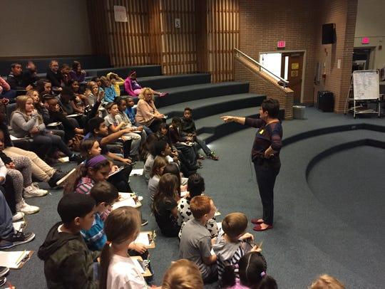 Children's book author Chrysa Smith (standing) talks