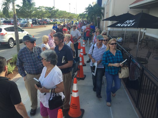Several thousand people line up at Books-A-Million at The Forum in Fort Myers to get a book signed by Republican presidential candidate Ben Carson.