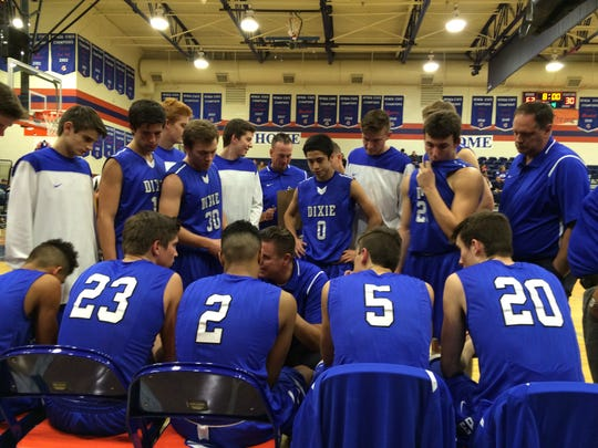 Dixie head coach Ryan Cuff talks to his team during a timeout. The Flyers fell 71-52 to Bishop Gorman (NV) in a non-conference showdown Saturday afternoon. Tyler Bennett scored 22 points to lead the Flyers.