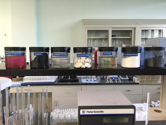 A row of chemicals and materials on display at the water treatment plant is used by the city of St. Cloud to remove contaminants from drinking water. The source of the water is the Mississippi River.