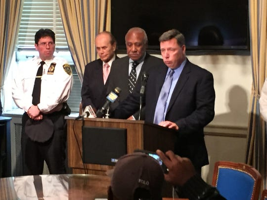 Former Mount Vernon Police Capt. Edward Adinaro, backed by then-Mayor Ernie Davis, recounts the shooting Friday, Oct. 24, 2014, of Anthony Smith, a 31-year-old man who, police say, lunged at officers with a knife and scissors.