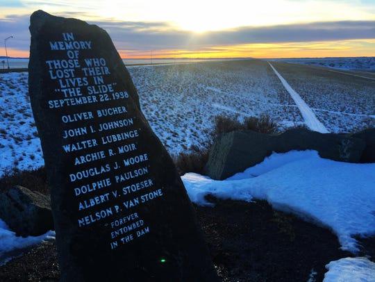 A memorial overlooks Fort Peck Dam.