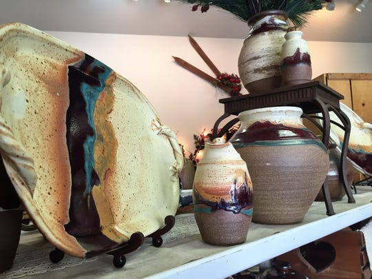 "Potter Gloria Jacobson created the color scheme ""copper plains,"" which she's used on new recent pottery."