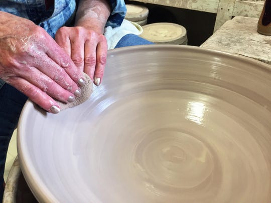 Gloria Jacobson shapes a bowl on her pottery wheel in her Hinsdale studio.