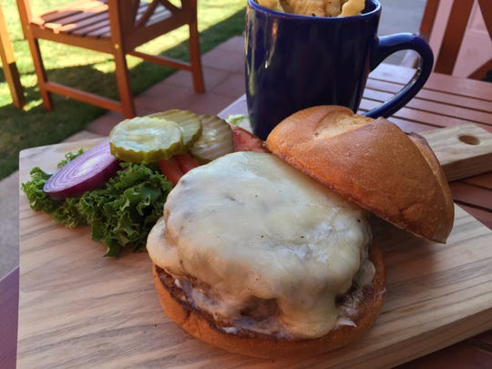 Feast offers several brawny burgers at lunch. This house burger is from spring 2016, when the restaurant first began serving lunch.