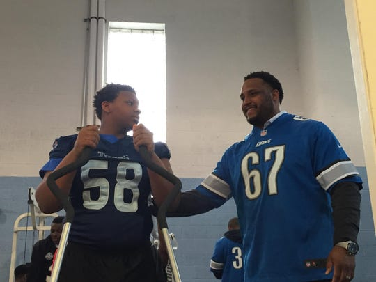 Former Lions offensive guard Rob Sims with Davion Weatherspoon, 13, on Thursday, April 7, 2016.