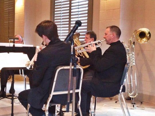Trumpeter Alan Suska, center, performs Sunday at St.