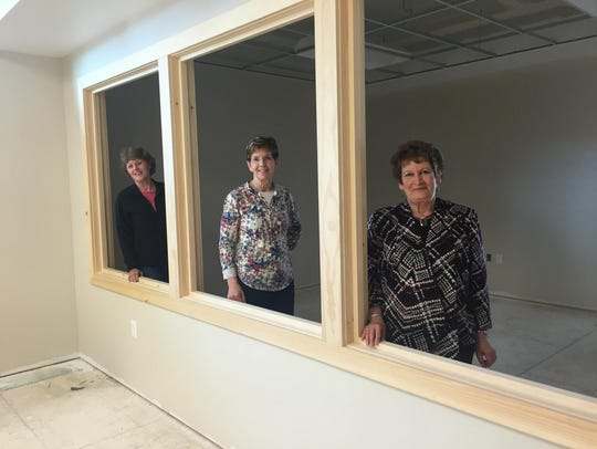 Marla Ray, Ann Quinn and Deloris Pribyl look into the