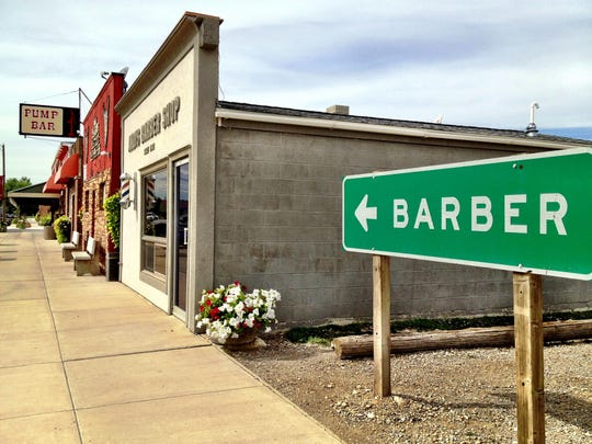 Don Andersen acquired the highway sign to the town of Barber and had it point to his shop. A construction project meant he had to stow it, but it's going back up this week.